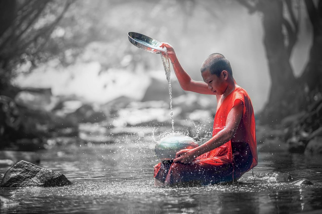 Boy Pouring Water